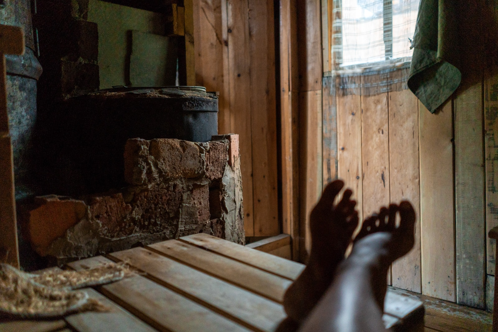 Feet while sitting inside a sauna in Siberia, Russia