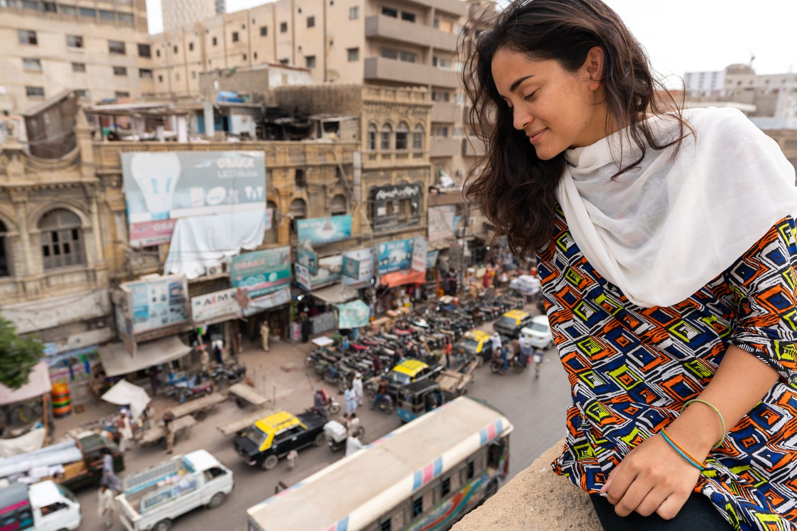 Girl sitting on a roof in Karachi, Sindh