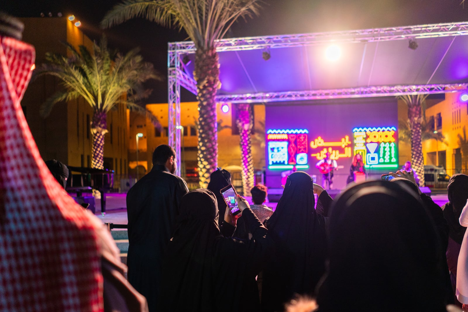 Women filming a concert on their mobiles in Riyadh, Saudi Arabia