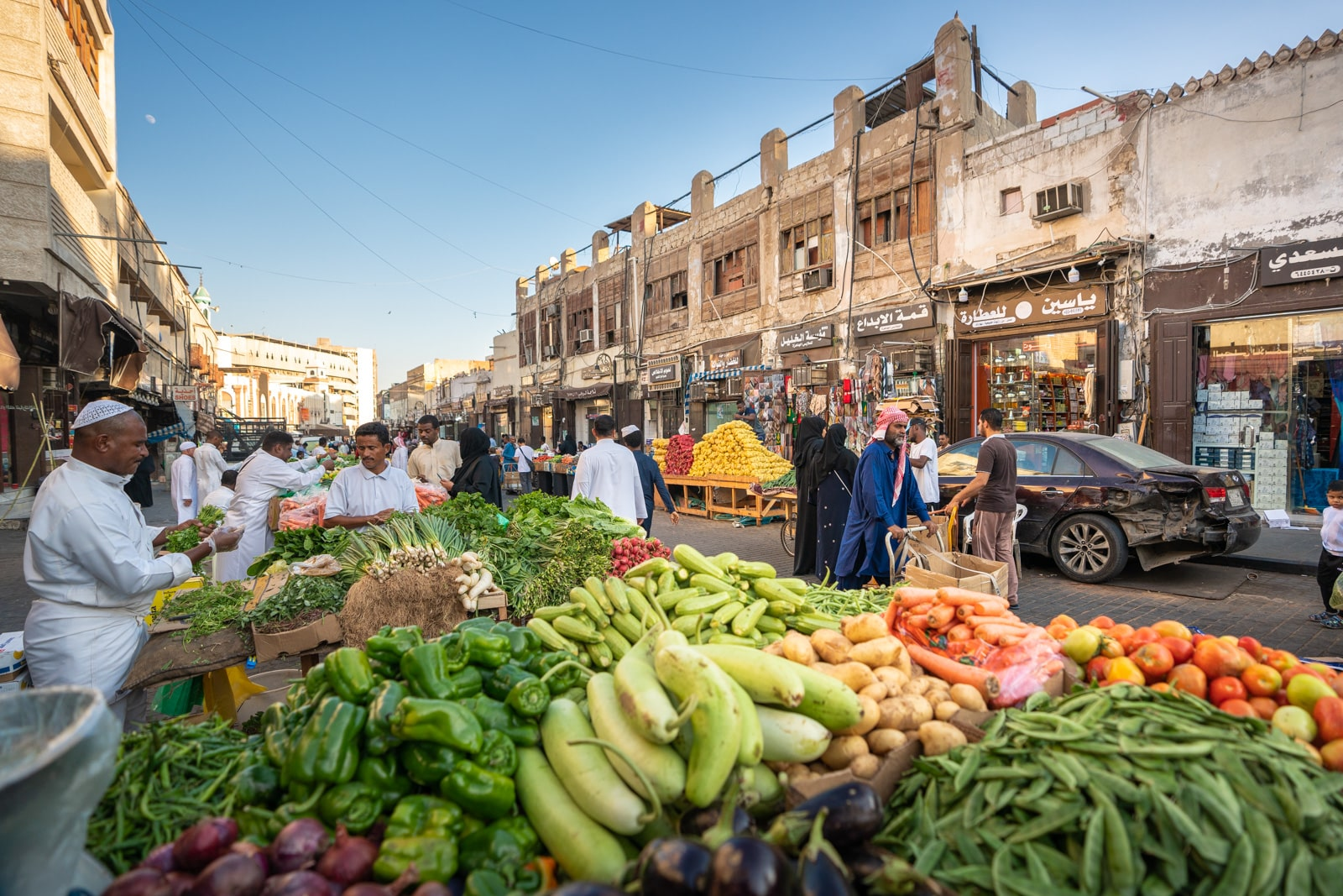 Vegetable vendors at a street market in Old Jeddah, Saudi Arabia