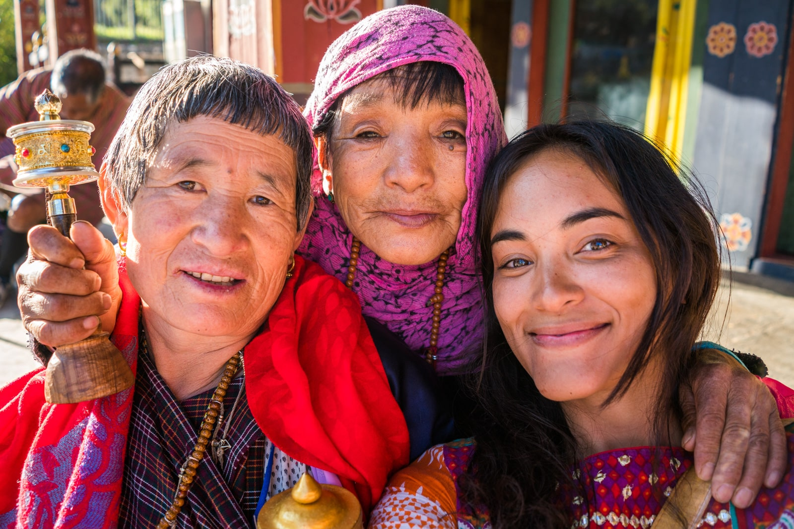 Female traveler with local women in Thimphu