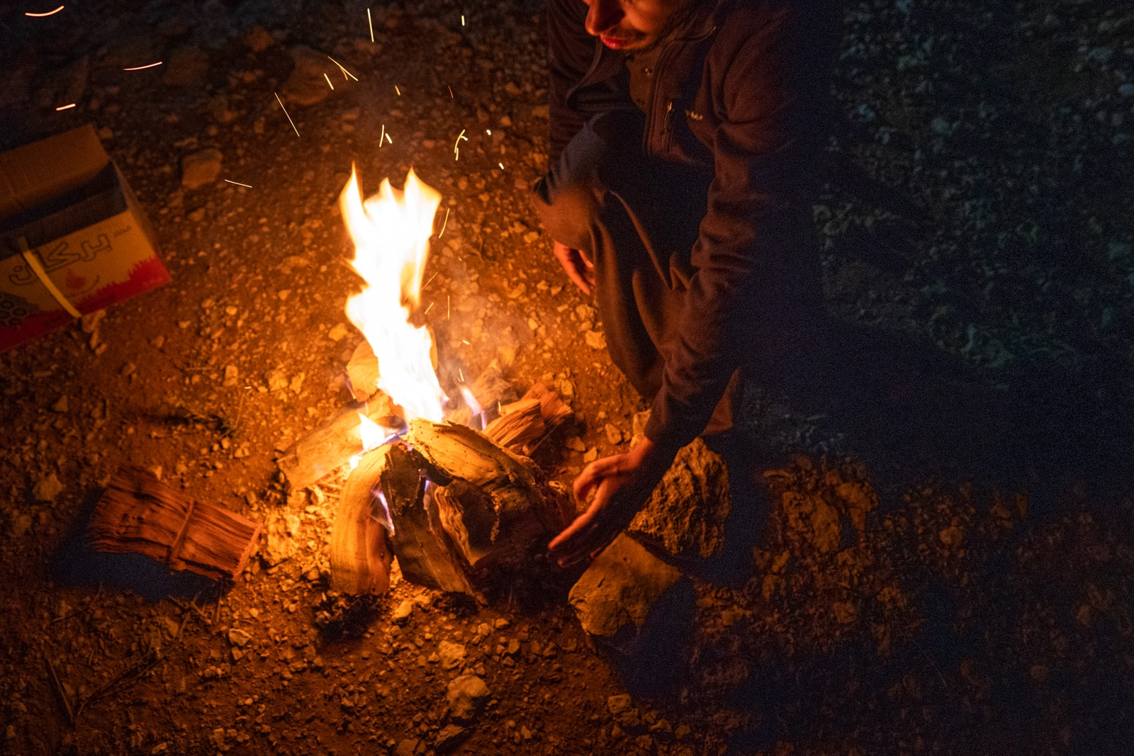 Saudi man making a campfire near Riyadh, Saudi Arabia