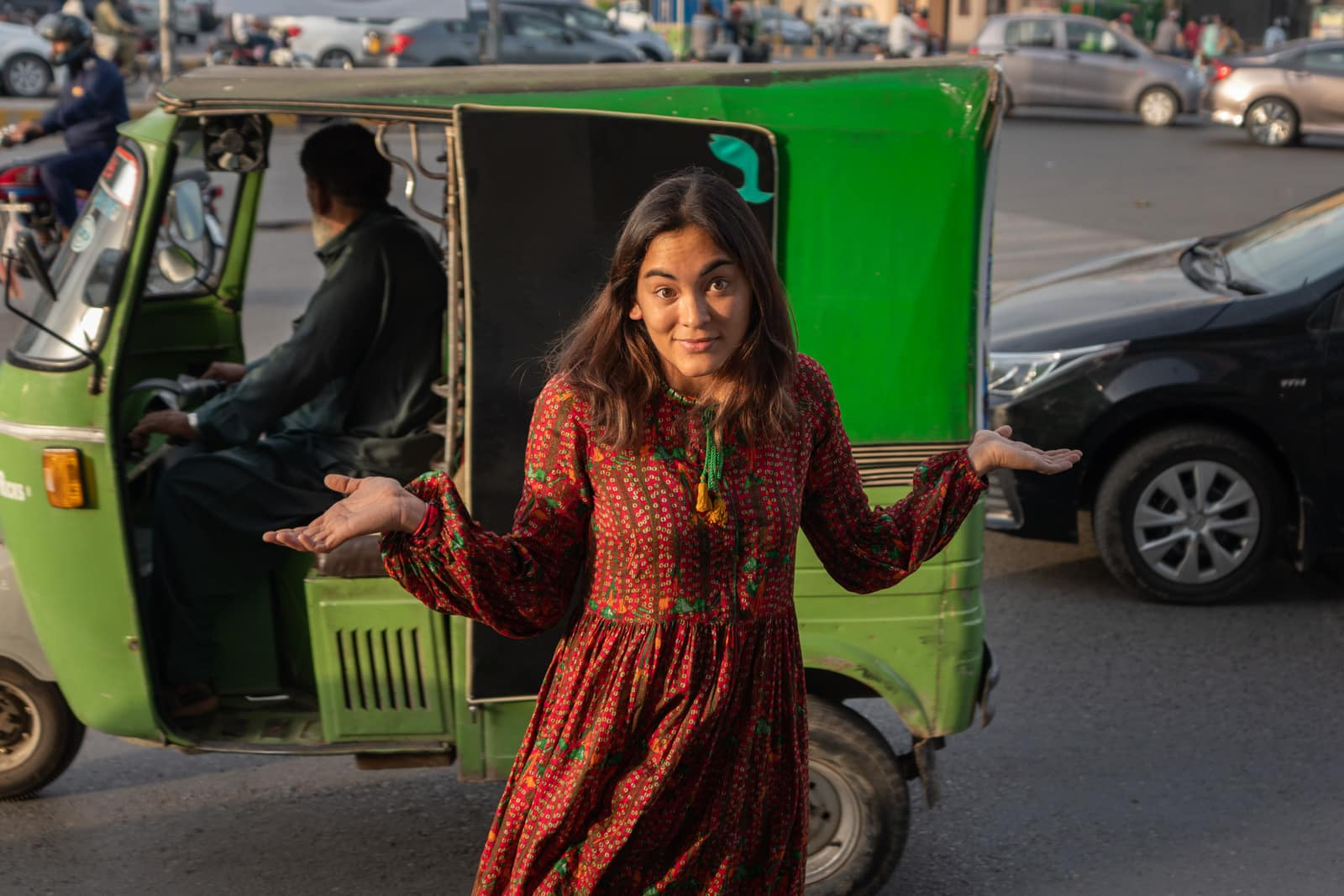Female traveler in Pakistan traffic