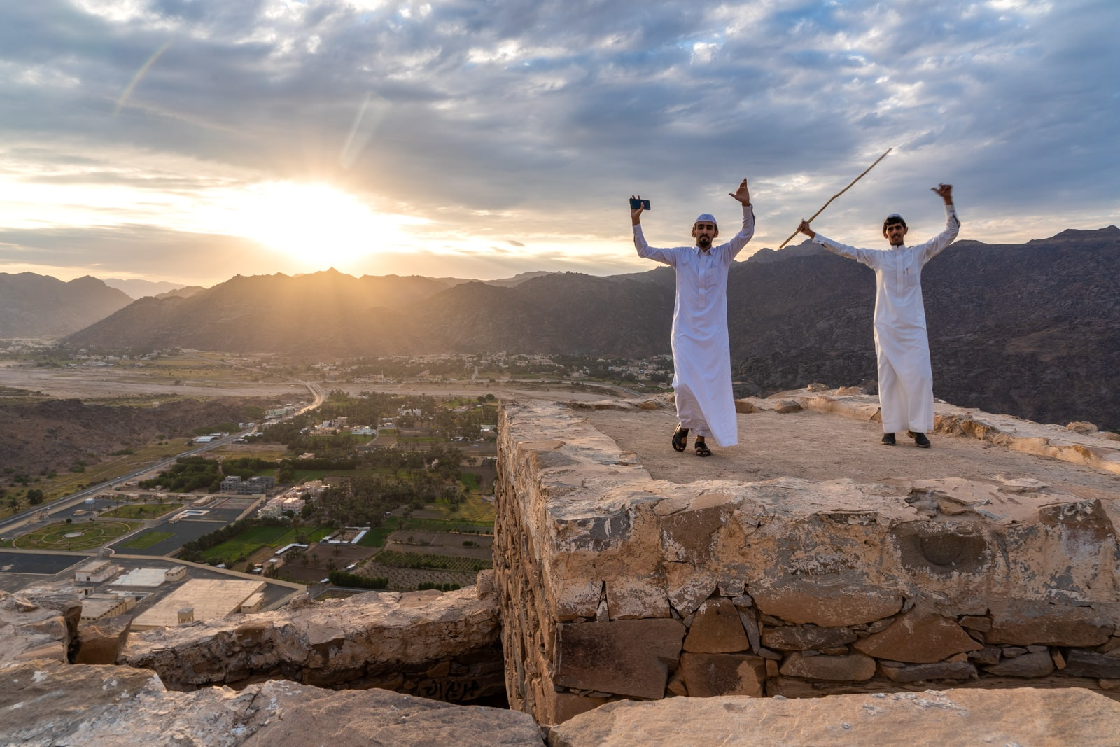Saudi boys dancing during sunset in Najran, Saudi Arabia