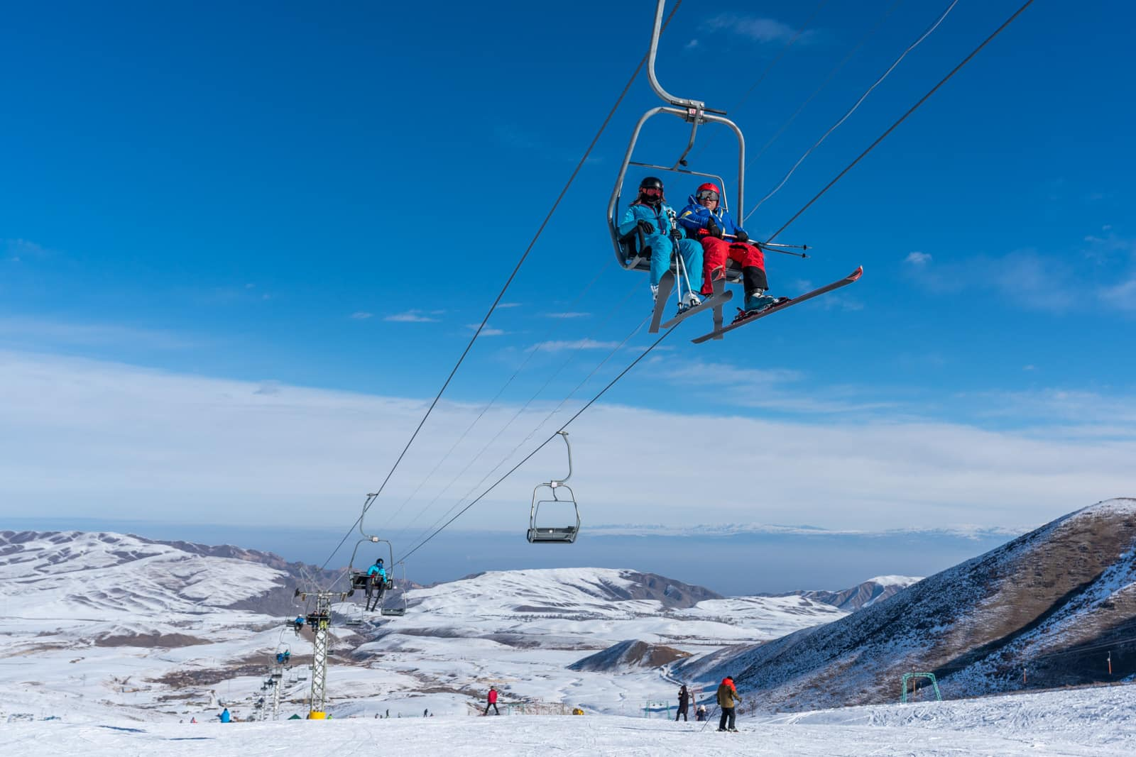 Skiers on a chairlift at ZIL ski base near Bishkek, Kyrgyzstan