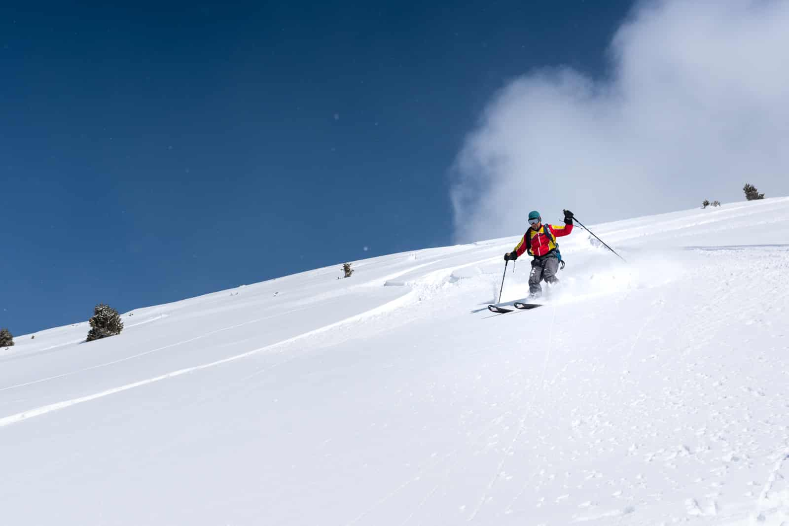 Backcountry skiing in powder in Boz Uchuk, Kyrgyzstan