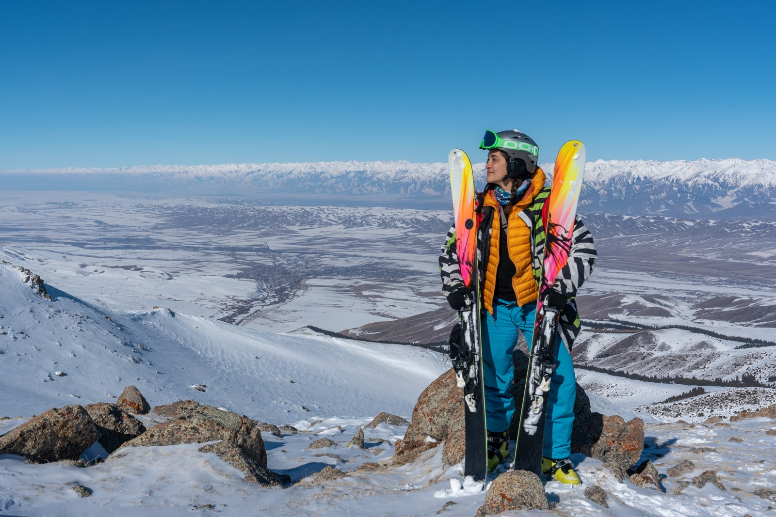 Female traveler skiing in Kyrgyzstan