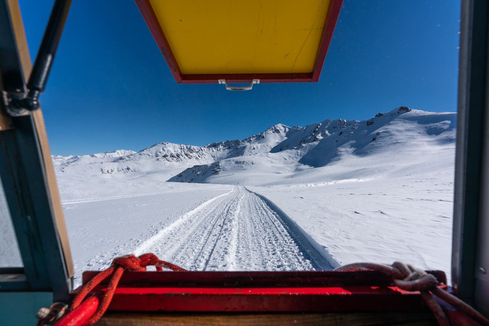 View of mountains from a snow cat for backcountry skiing near Jyrgalan, Kyrgyzstan in winter