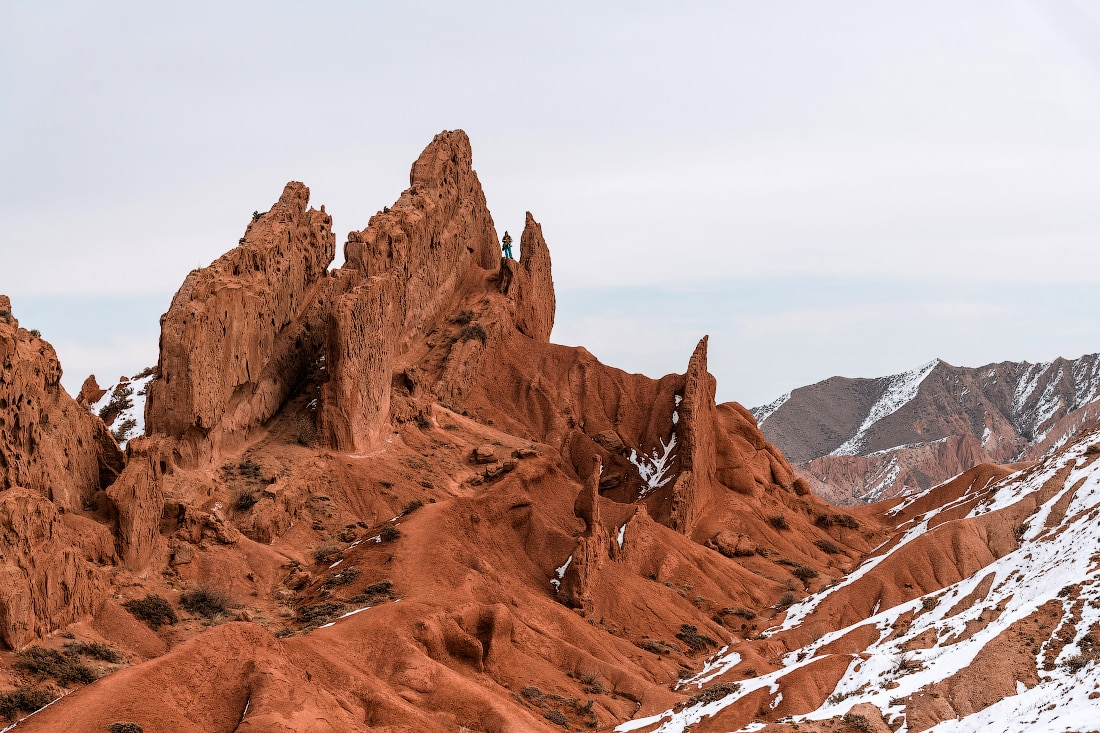 Hiker in Fairytale canyon, Kyrgyzstan with snow
