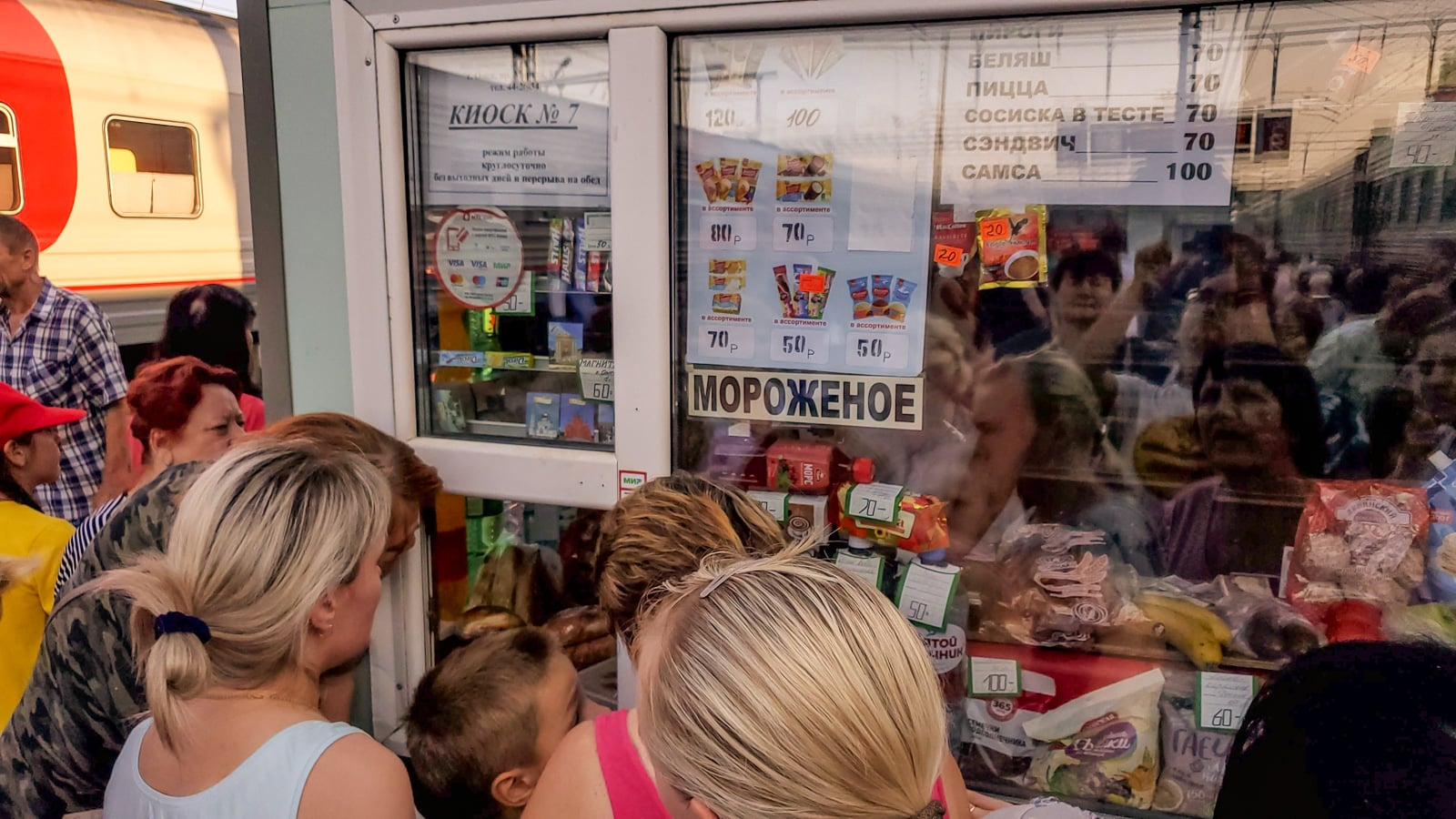 Passengers buying ice cream at a Russian train station