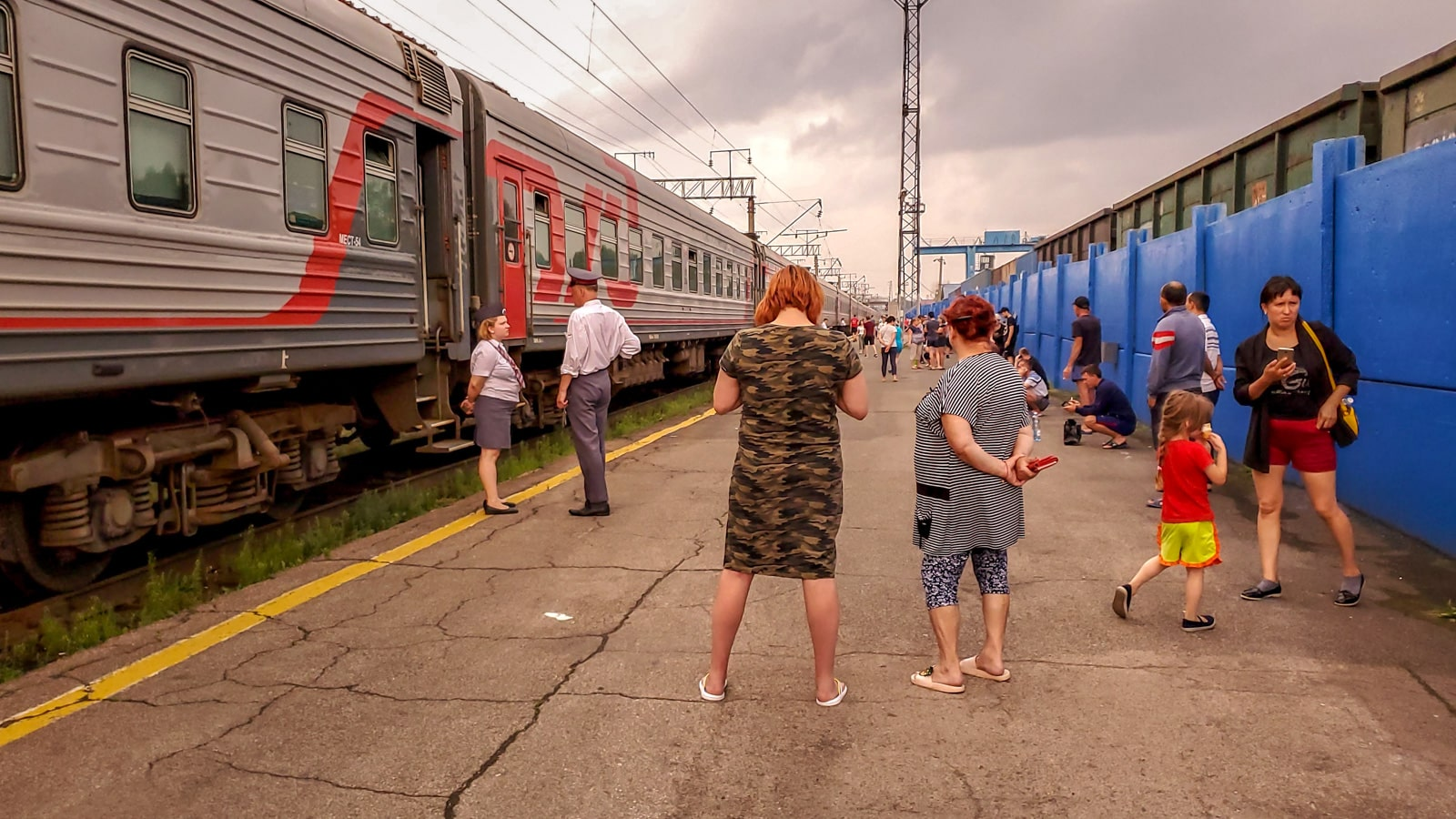 Train passengers standing at Marinsk train station, Russia