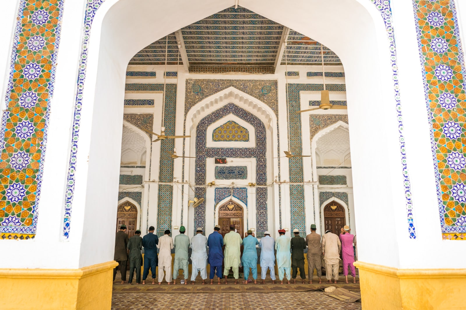 Men praying at a shrine in Hala, Sindh, Pakistan