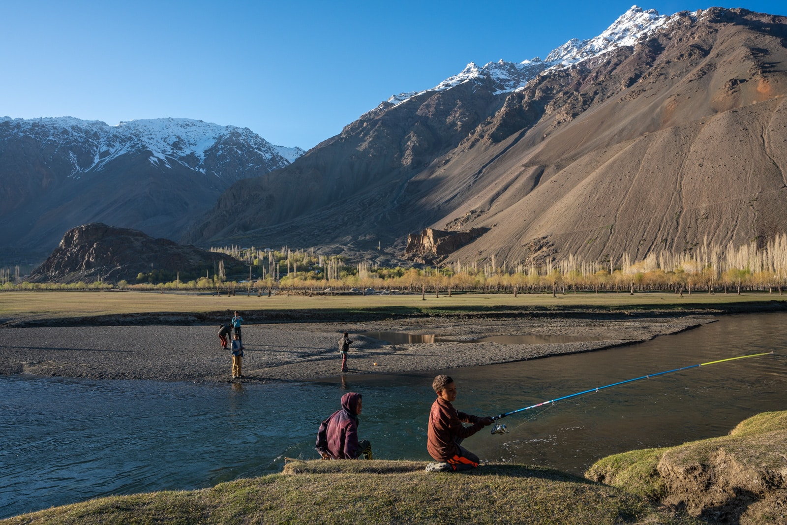 Young boys fishing in Phander, Gilgit Baltistan