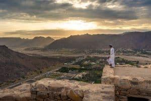 Boys watching a sunset in Najran, Saudi Arabia