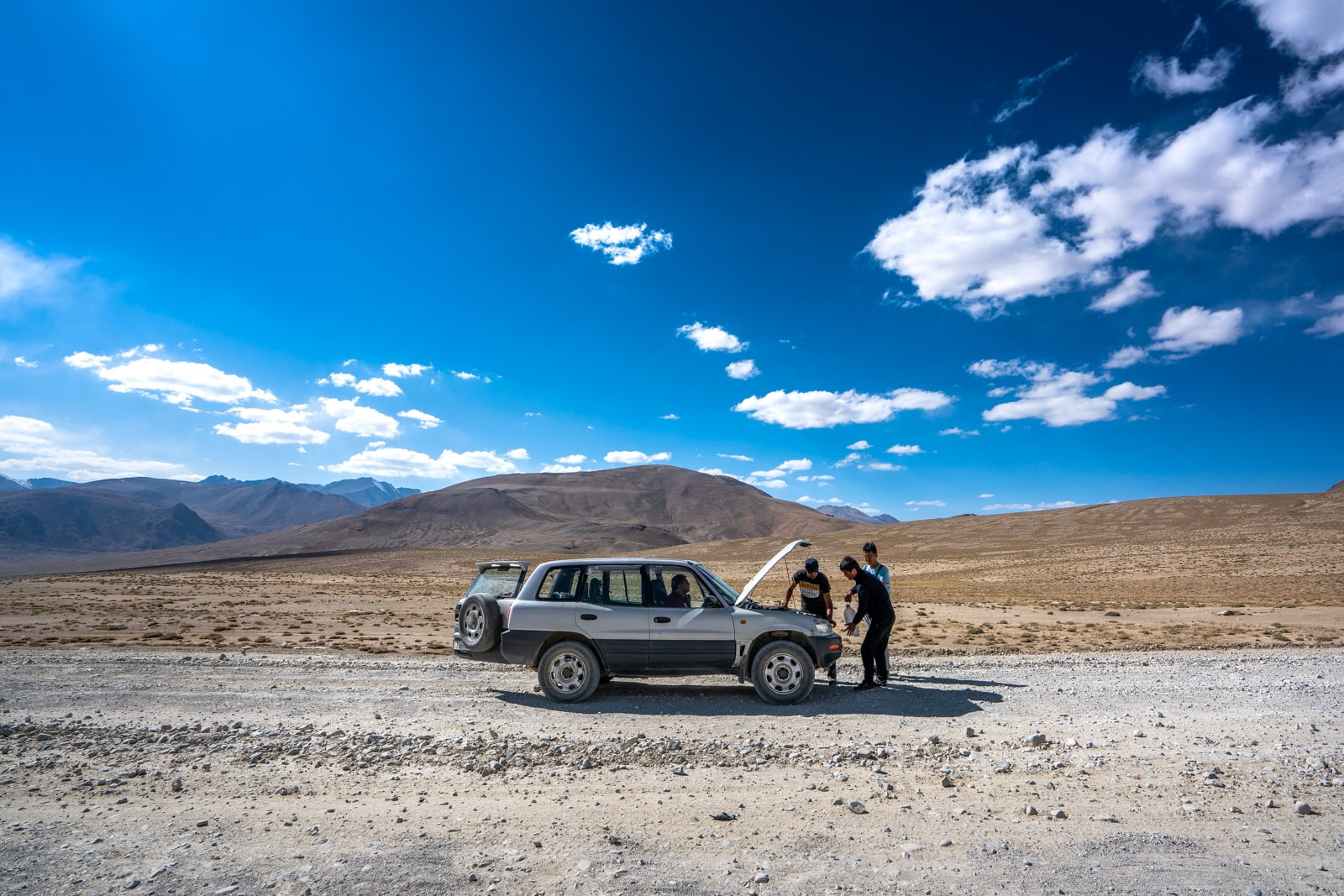 Shared taxi breaking down on Pamir Highway in Tajikistan