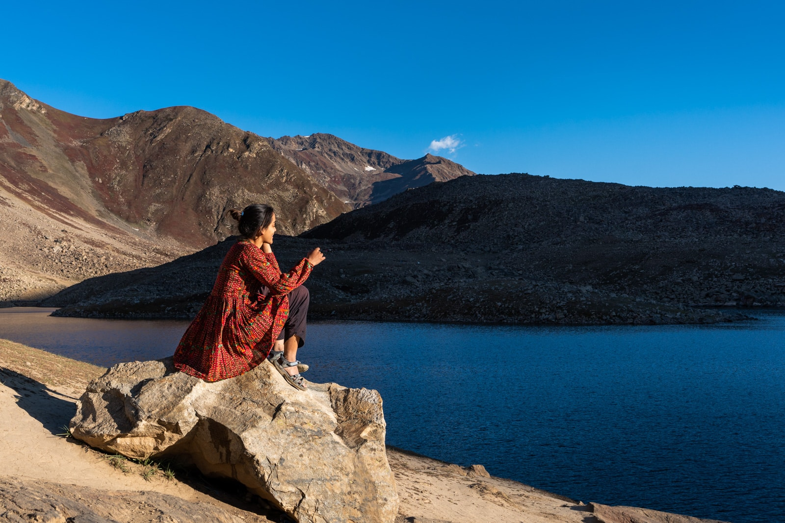 Female traveler at Lulusar Lake in Pakistan