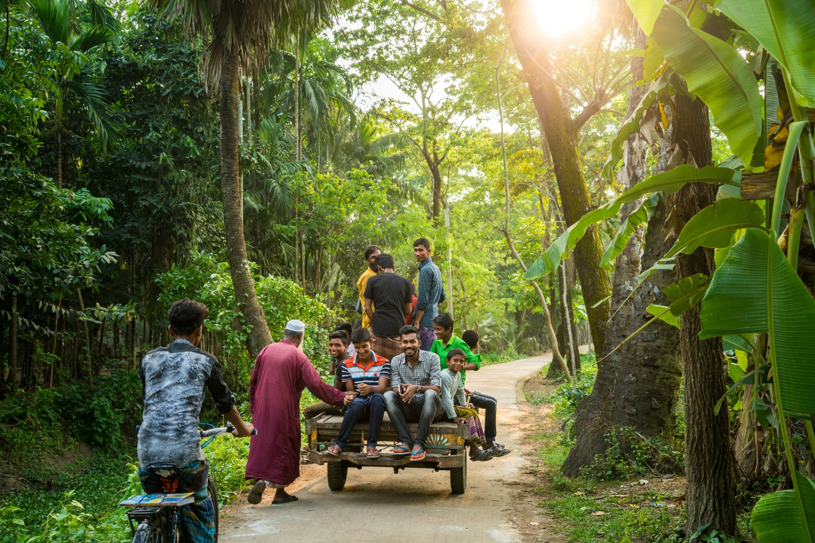Men and boys riding a van in Monpura island, Bangladesh