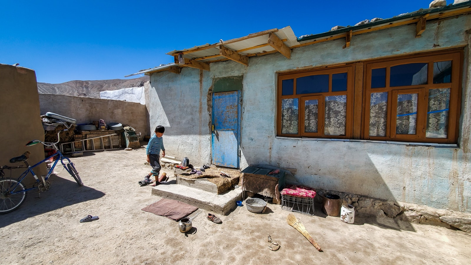 Boy outside his home in Murghab, Tajikistan