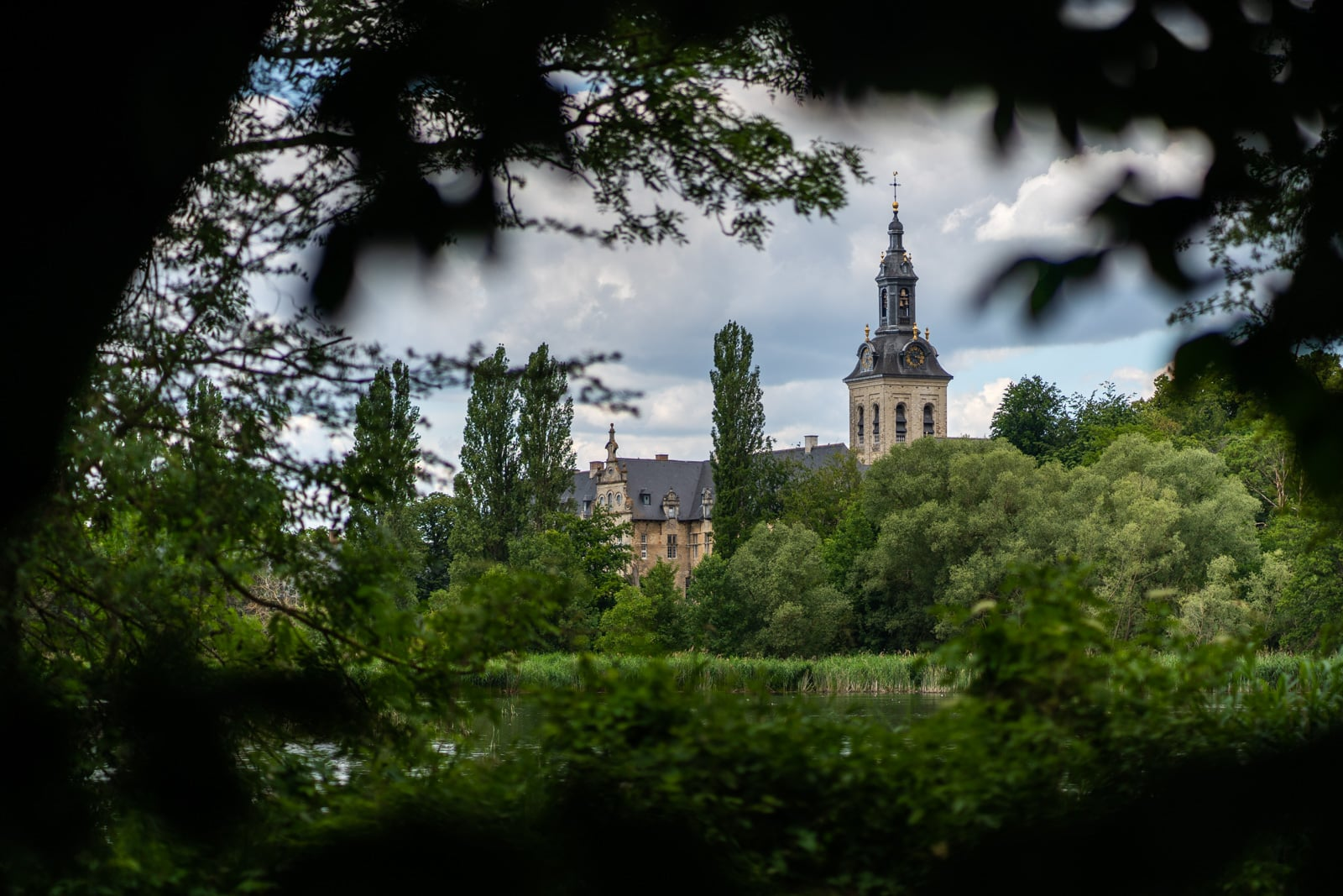 Park Abbey through the trees in Heverlee, Flemish Brabant, Belgum