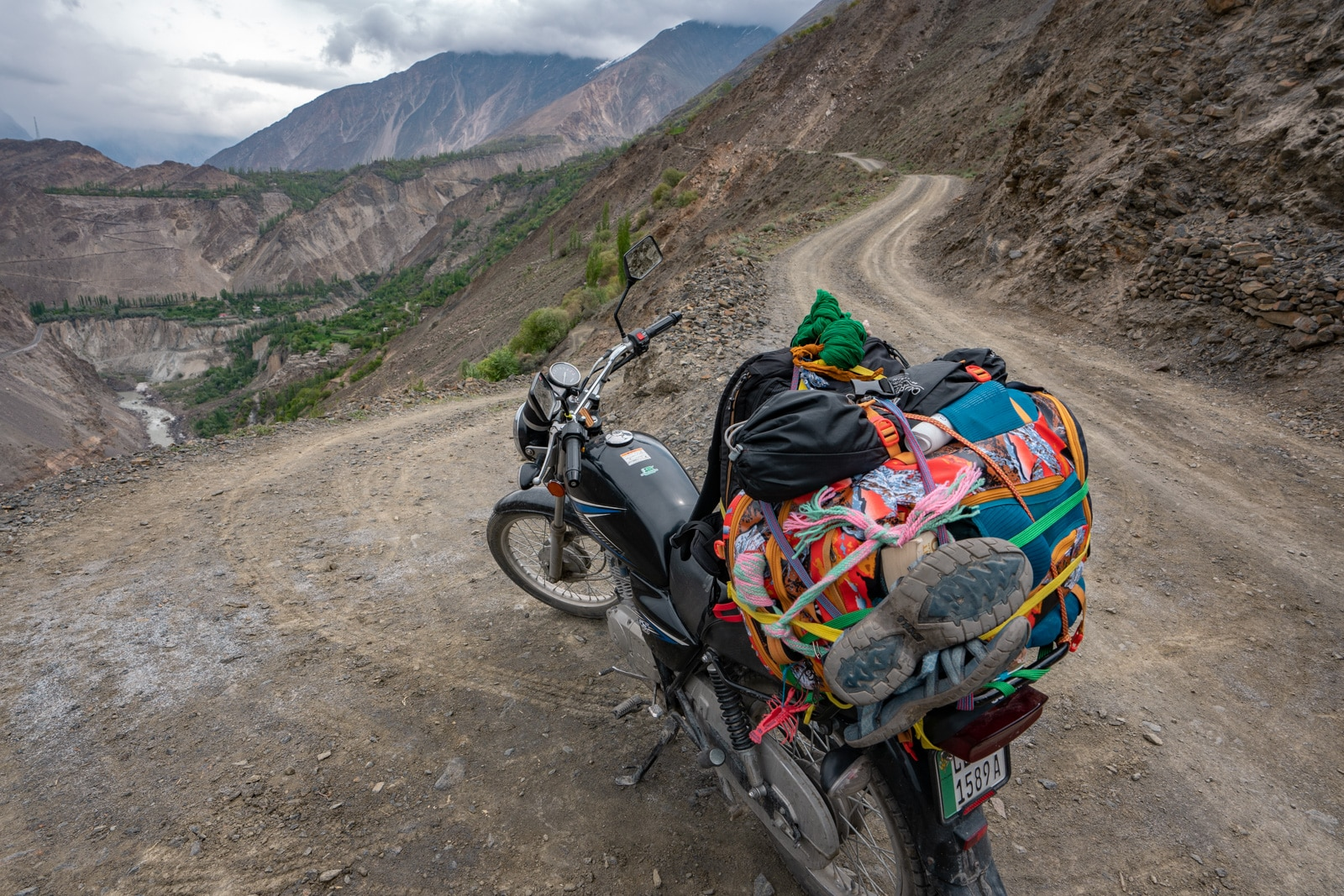 Motorbike with bags tied to it in Gilgit-Baltistan, Pakistan