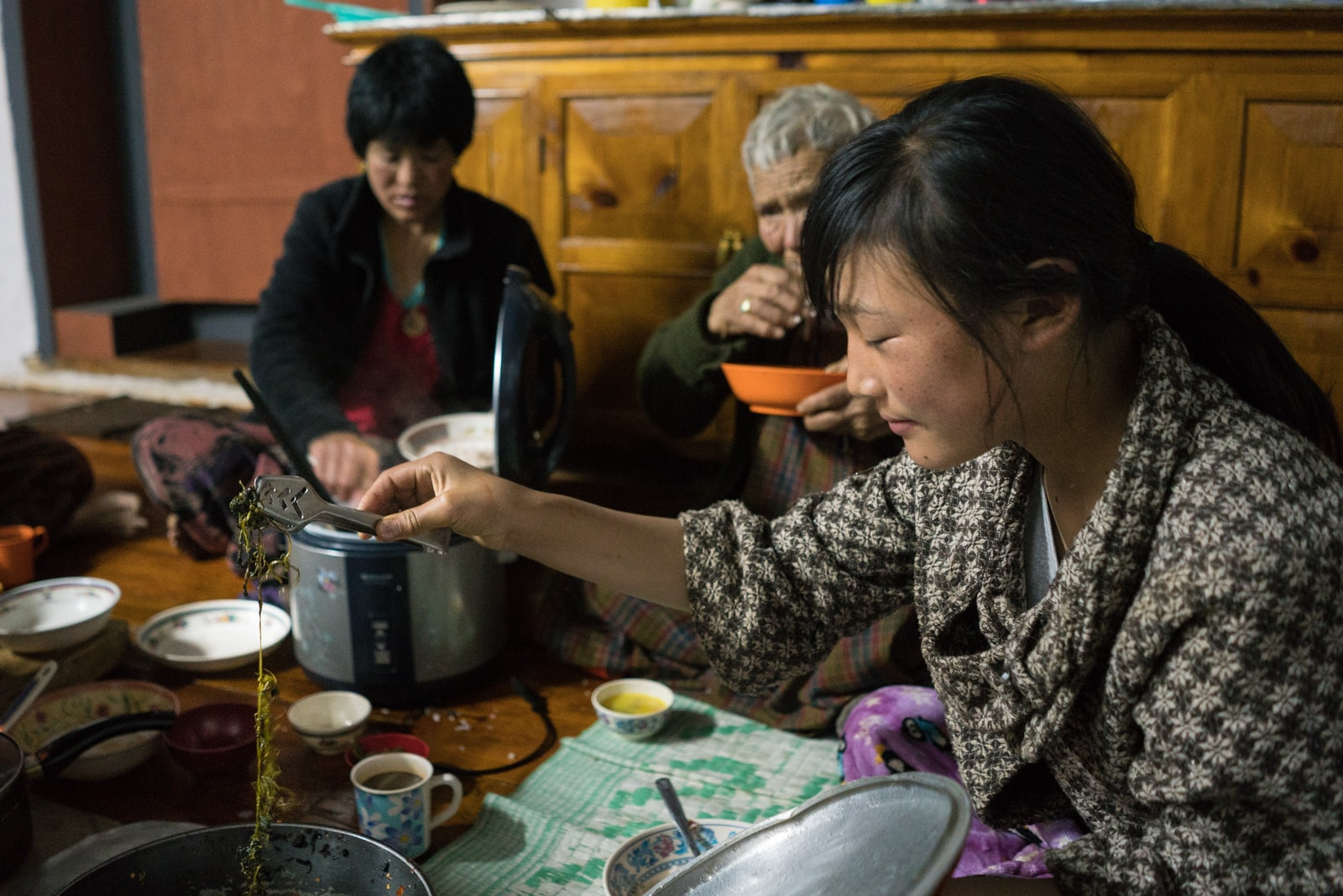 Dinner with a homestay family in Phubjika Valley, Bhutan