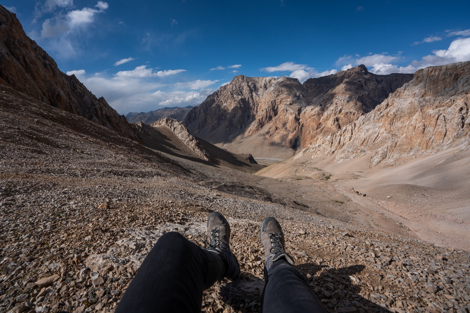 Taking a break on a mountain pass while trekking in the Pamir Mountains around Shaimak