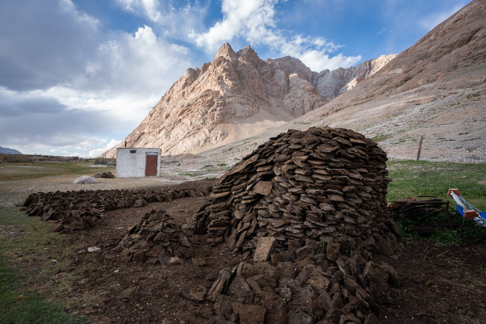 Pile of cow dung for fires in Shaimak, Tajikistan
