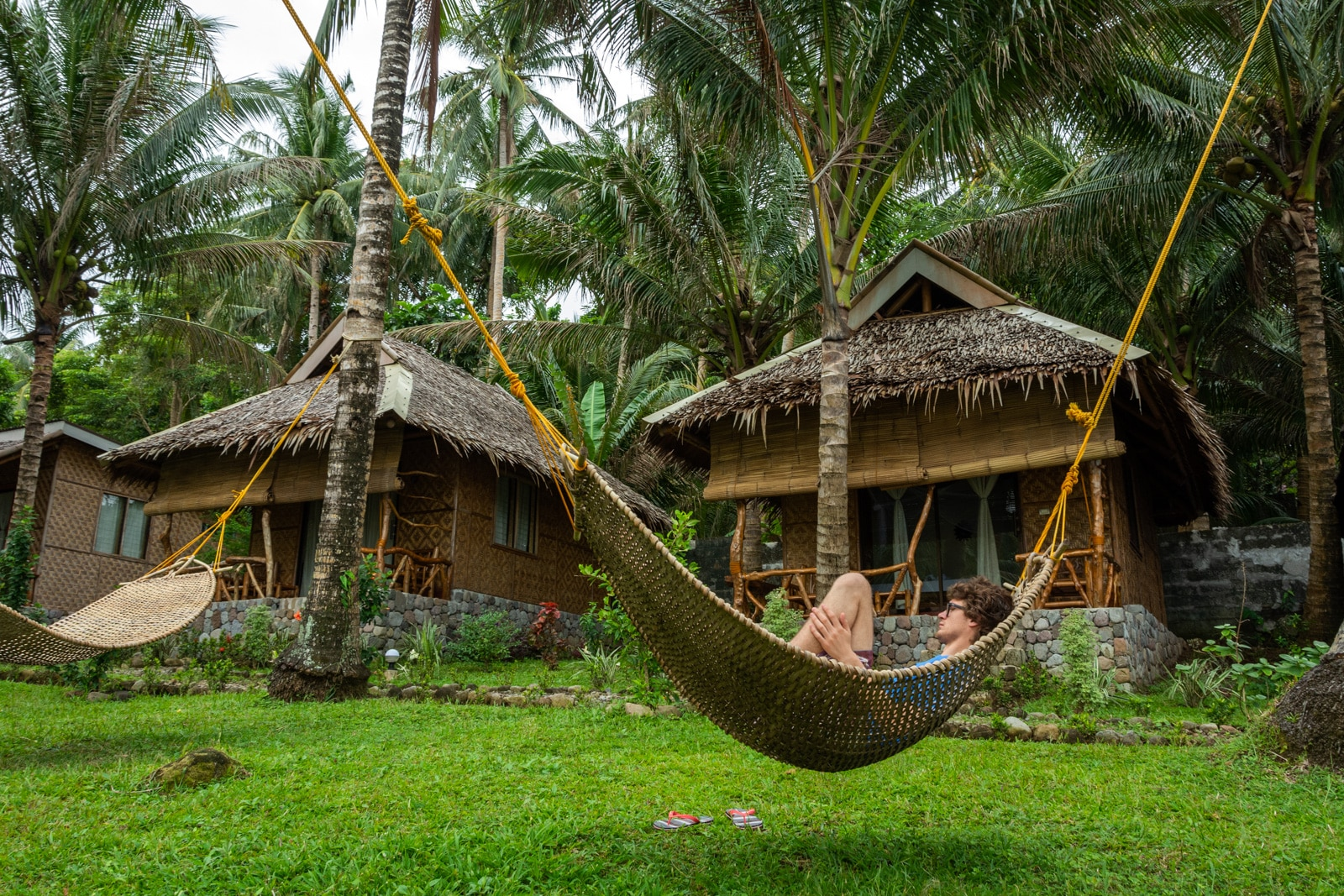 Boy relaxing in a hammock at Volcan Eco Resort on Camiguin Island, Philippines