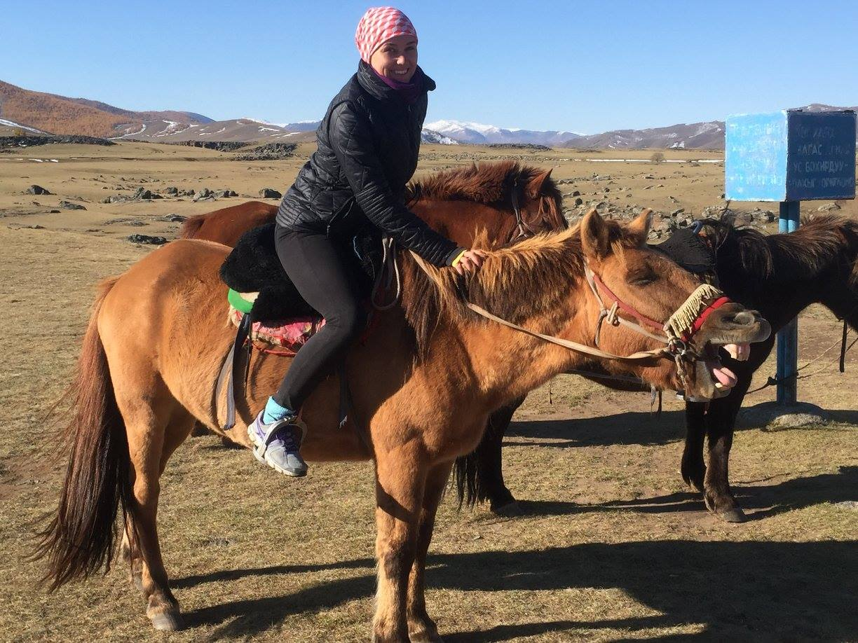 Ana on a horse in Mongolia