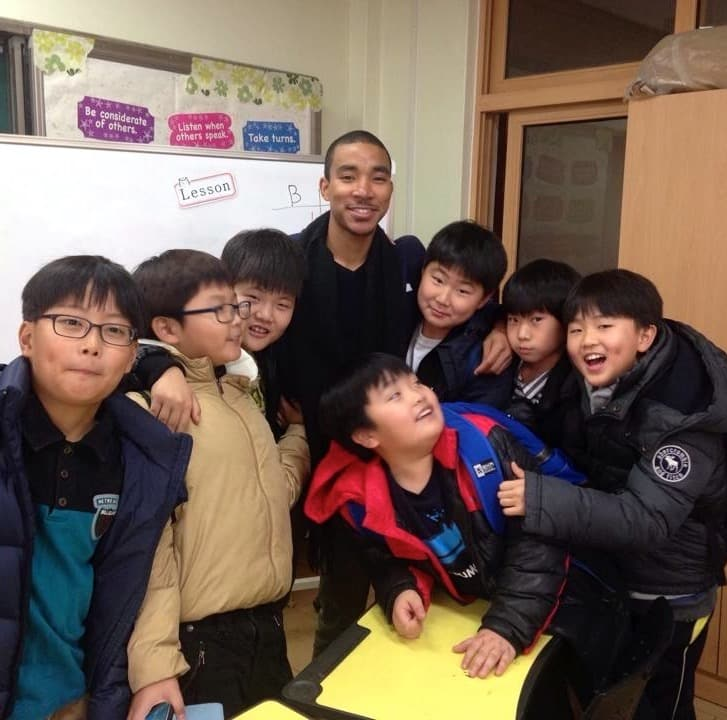 Tyreek with English students in South Korea