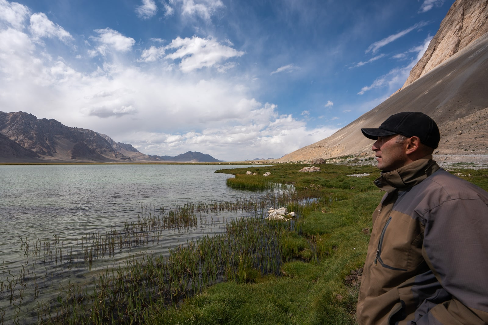 Local man at a lake in the Pamir Mountains of Eastern Tajikistan