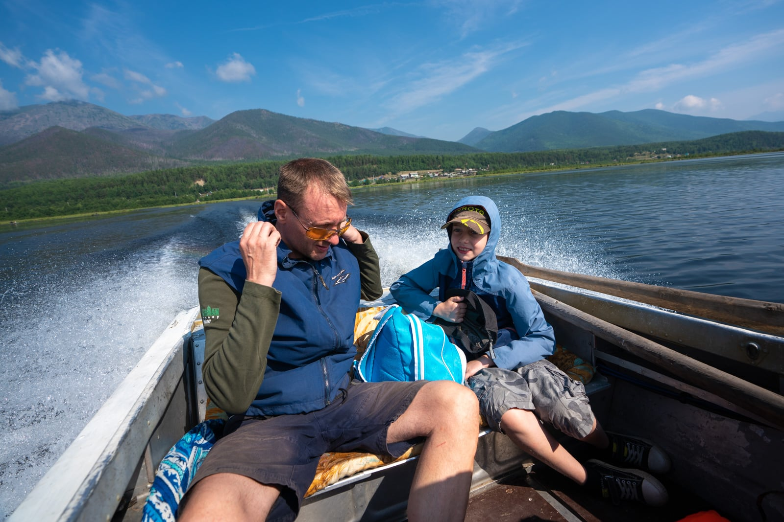 Russian man and his son on a boat in Lake Baikal in Siberia, Russia