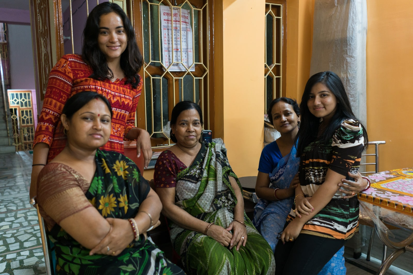 Alex with a family of women in a home in Kolkata, India