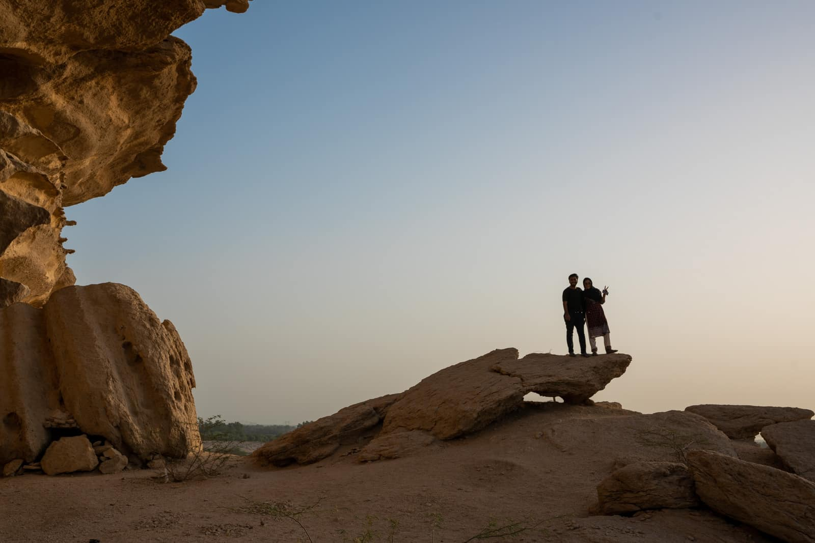Silhouettes of Alex with a local traveler friend in Sindh, Pakistan