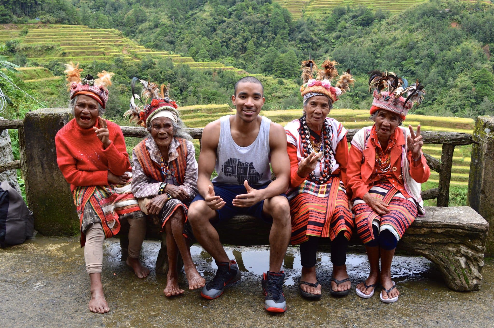 Tyreek with old women in the Philippines