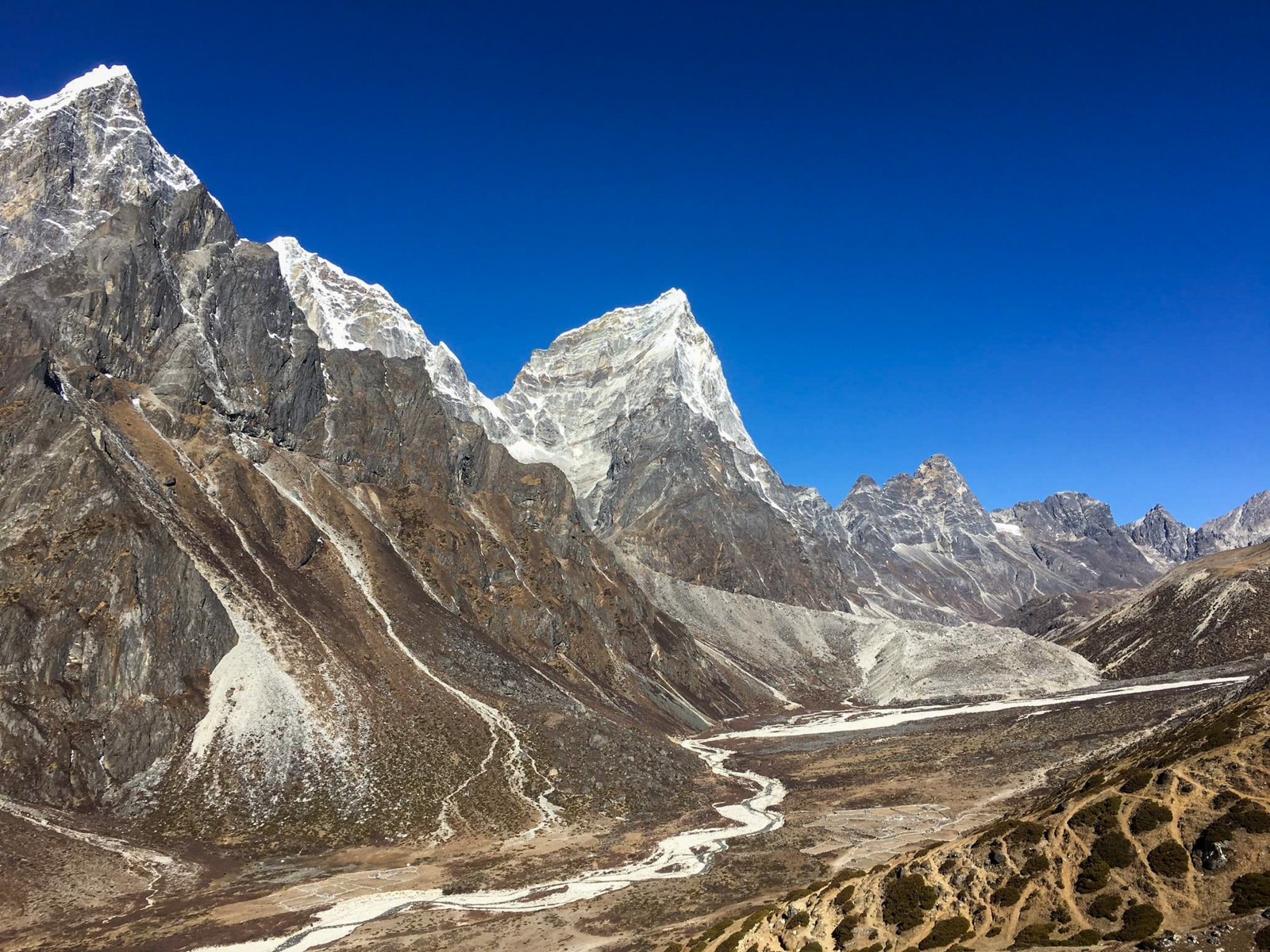 Mountain-lined valley near Dughla along the Everest Base Camp trail in Nepal