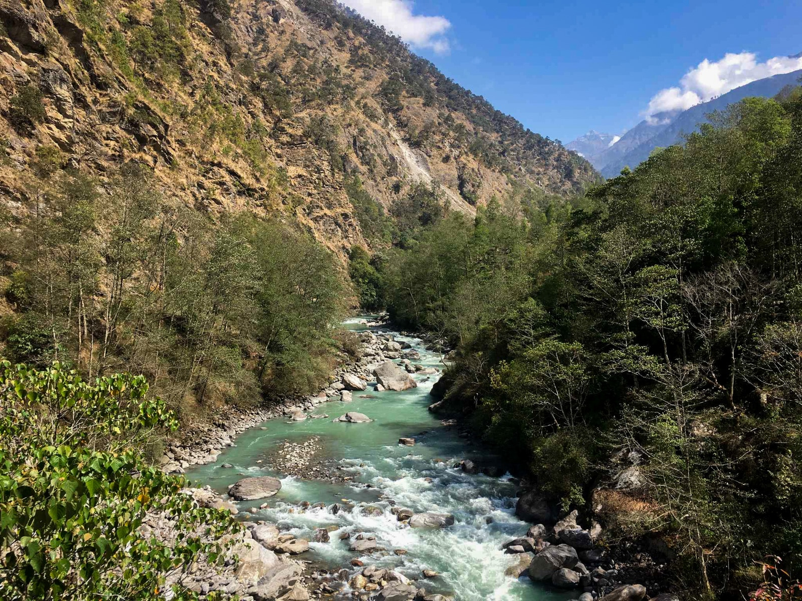 River flowing through a green mountain valley on the Jiri - Cheplung trail in Nepal