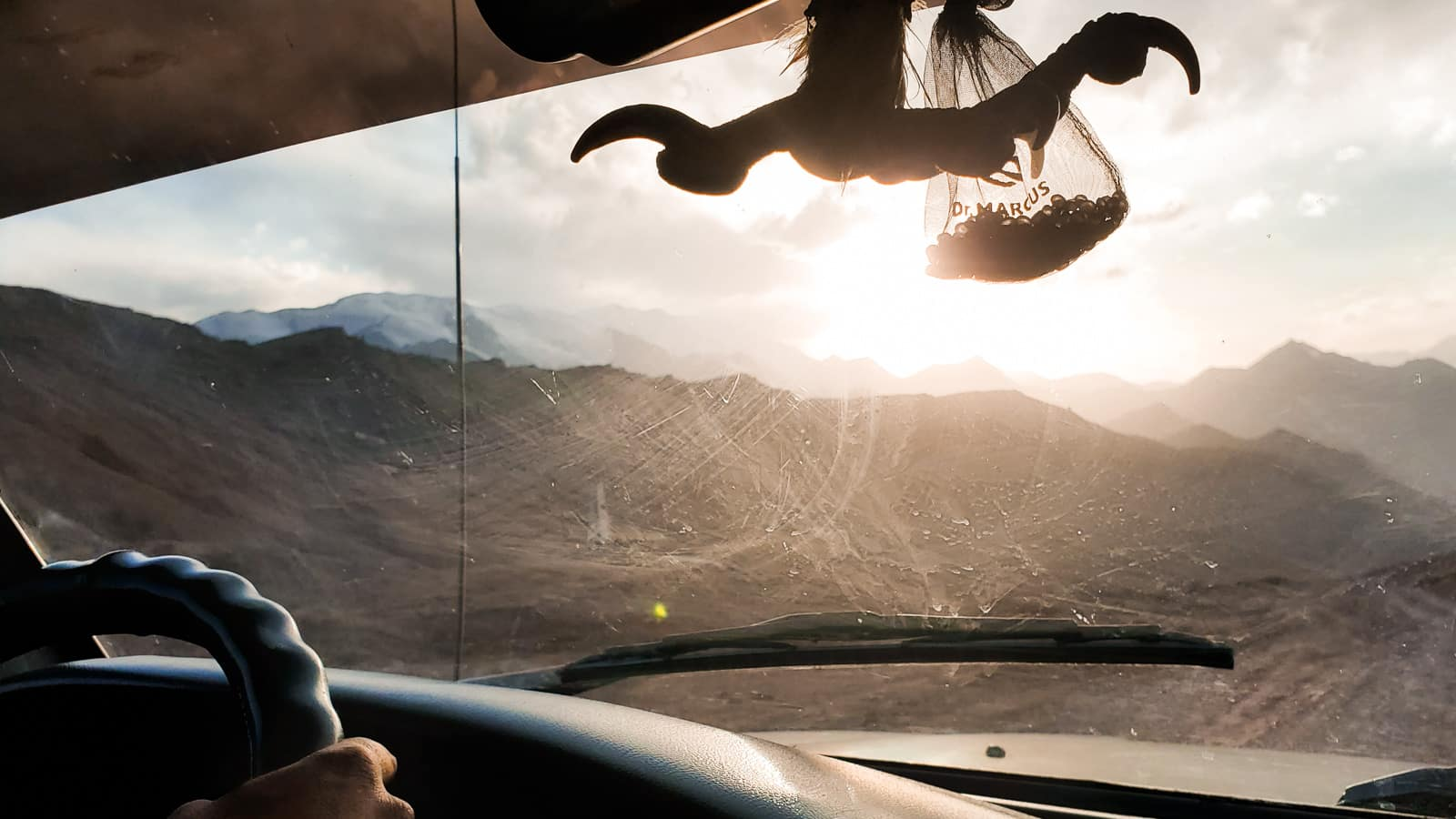 Eagle talon hanging from a jeep in Tajikistan