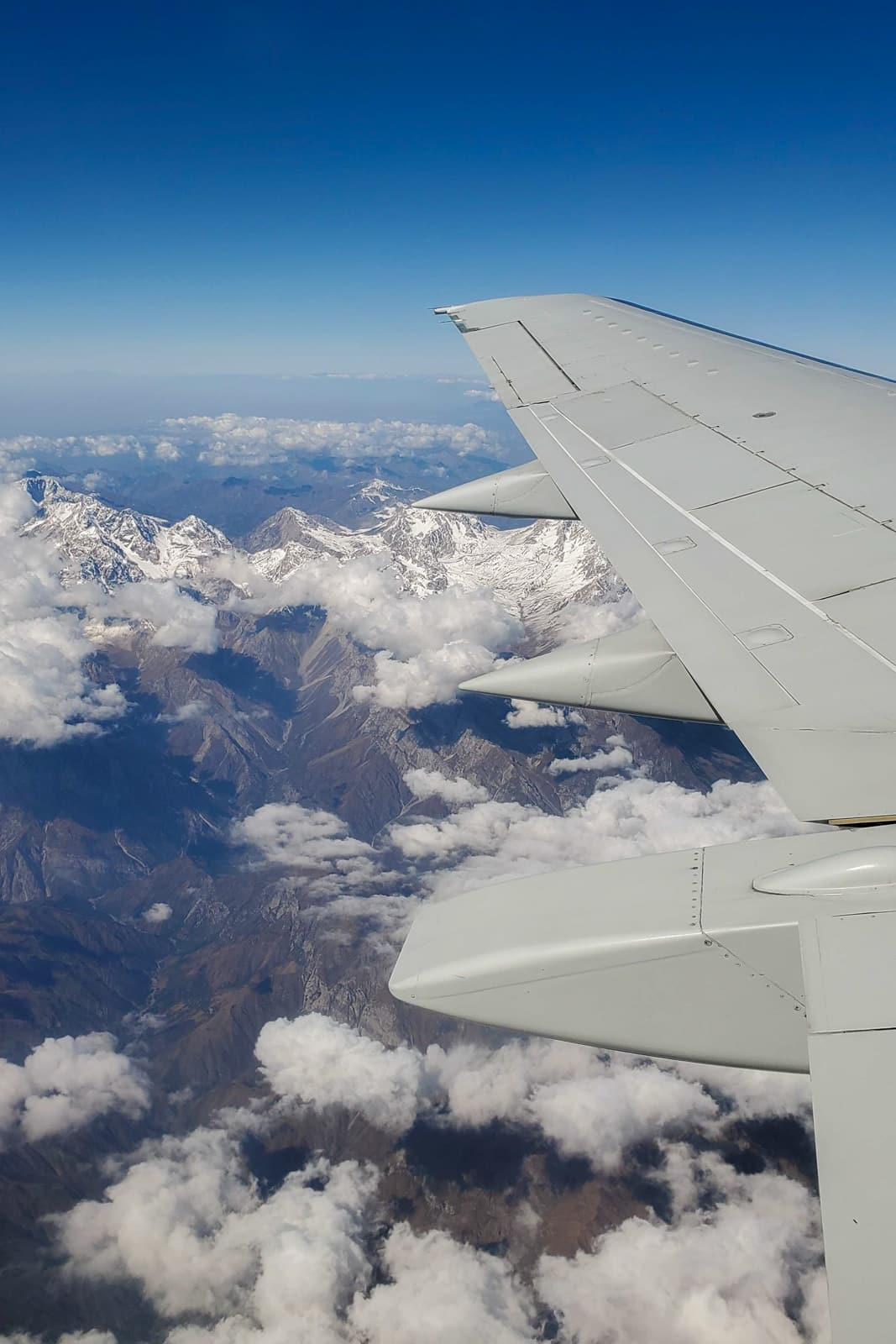 Plane wing over mountains in Kyrgyzstan