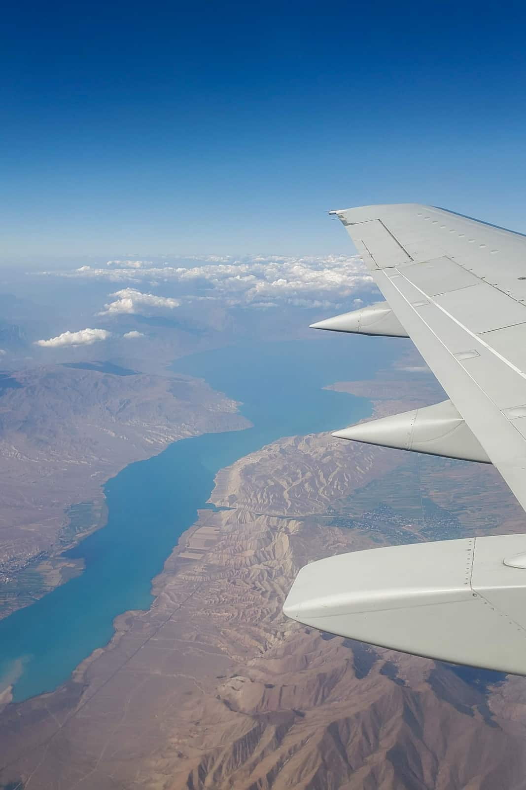 Plane wing over a lake in Kyrgyzstan