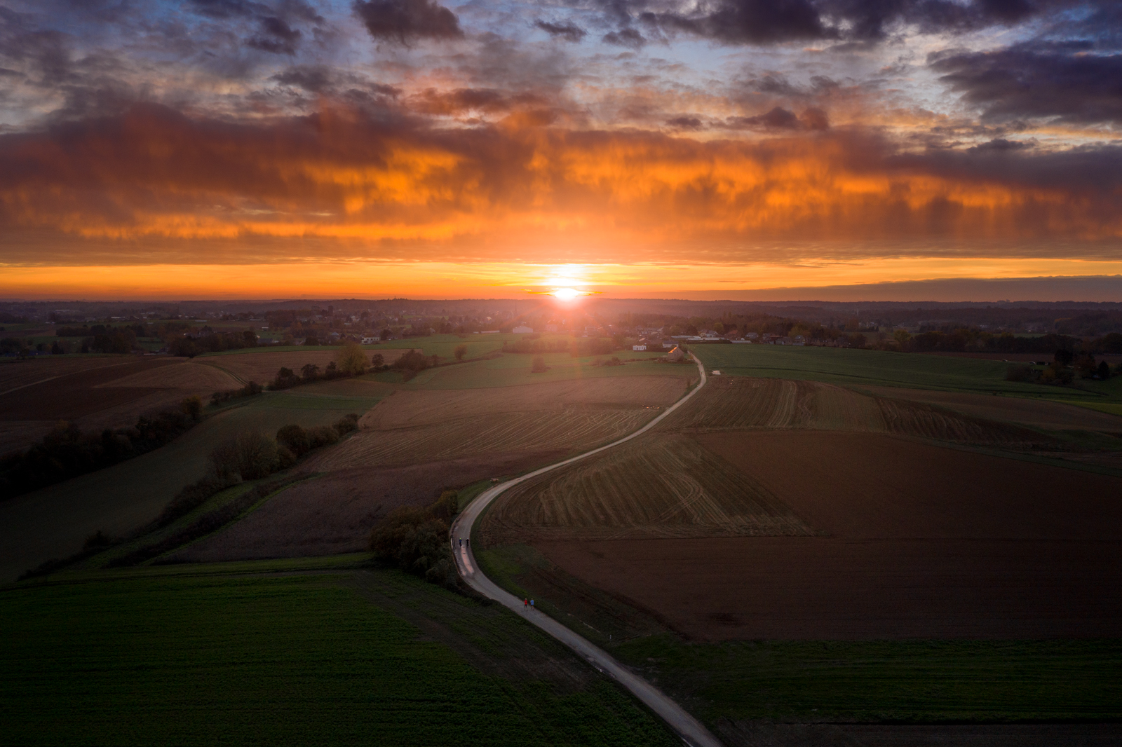 Fiery sunset over the bike path to Vossem, Belgium