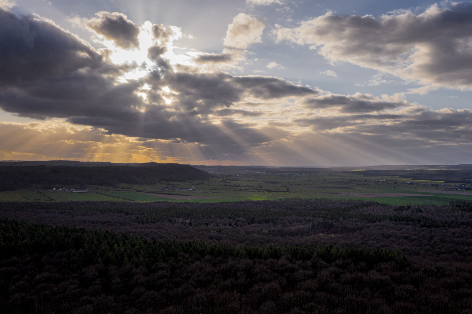 Rays of light breaking through clouds over Wallonia, Belgium