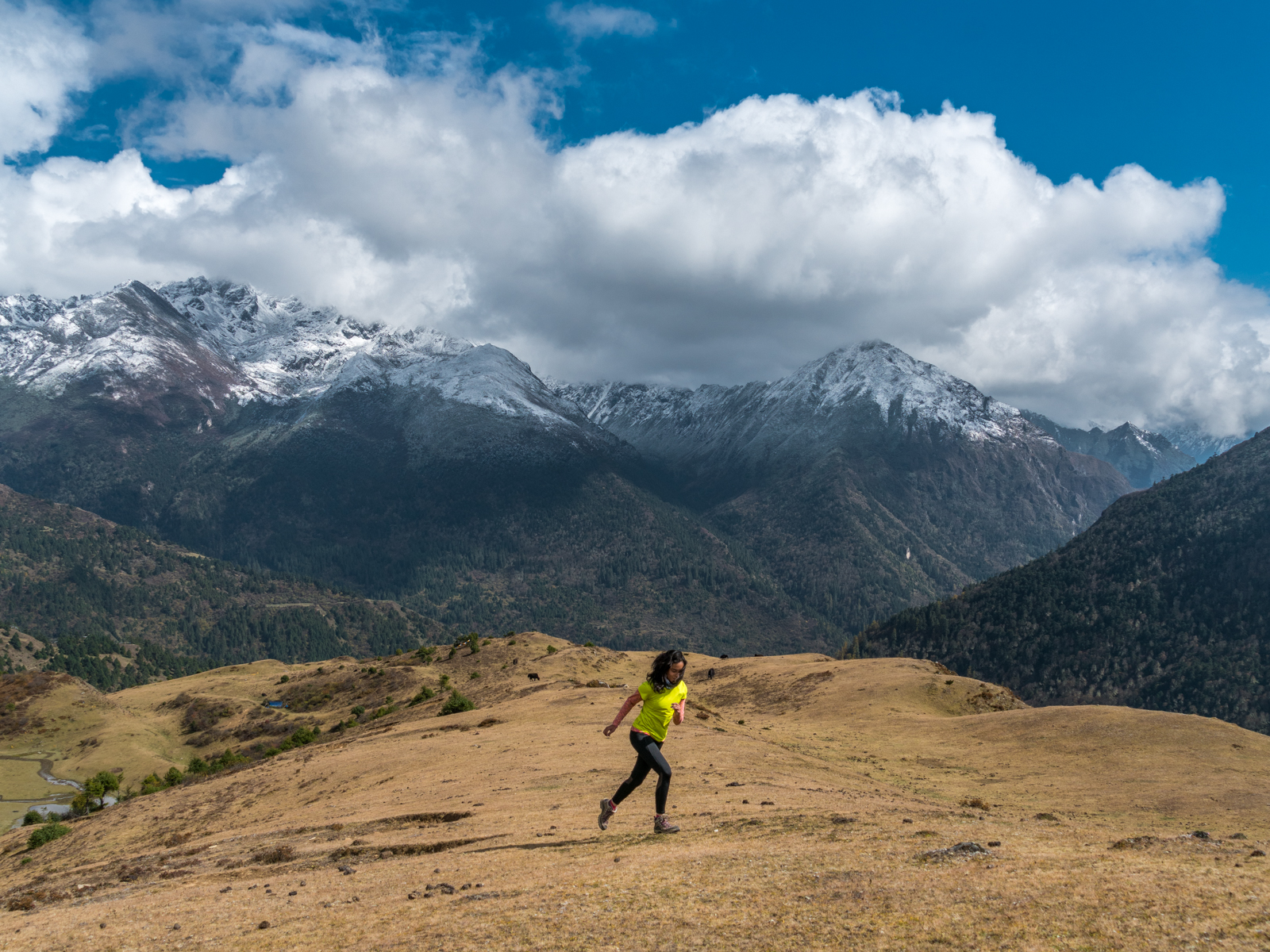 Alex running at high altitudes in the Himalaya Mountains of Bhutan